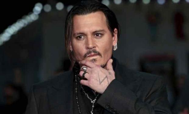 Johnny Depp sarà l'invetore dell'antivirus McAfee in King of the Jungle